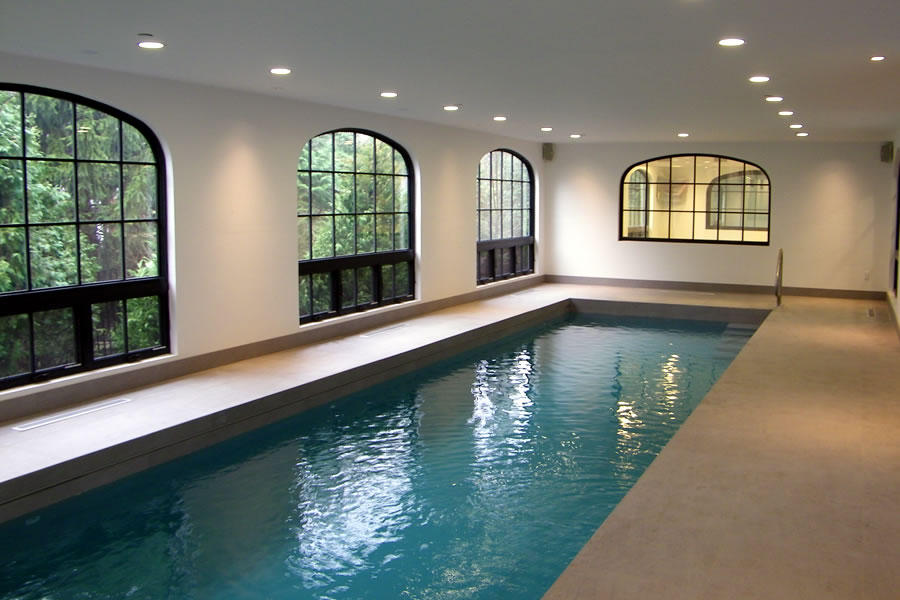 Indoor lap pool and spa with pool cover residential pool for Indoor swimming pool cost to build