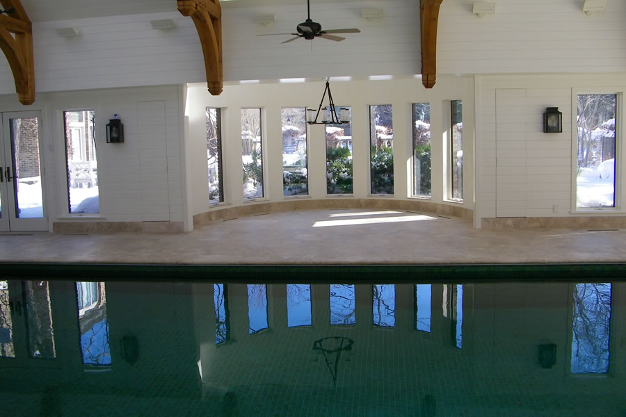 Indoor pool with custom tile residential pool design by for Indoor pool dehumidification design